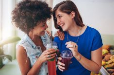 Cheerful young friends having fresh juice stock photo