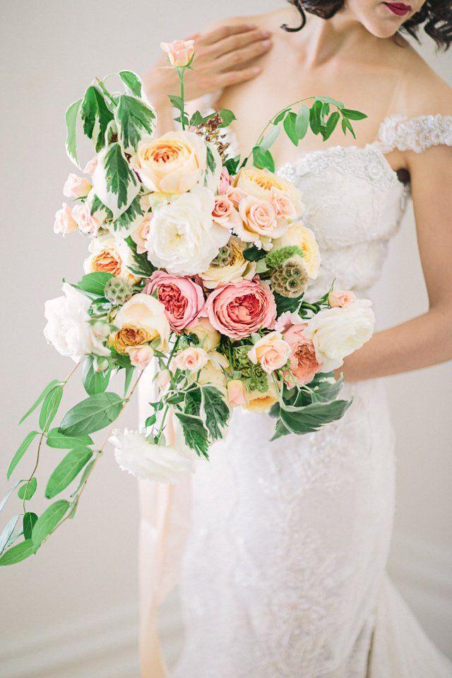 photo: Retrospect Images; Sexy elegant wedding dress and bouquet idea;
