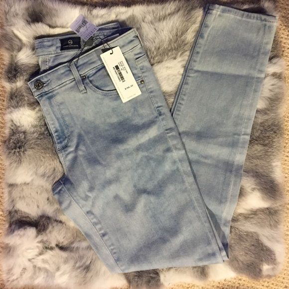 The AG legging ankle jeans Super skinny fit with leather logo patch and packet. Super light wash that goes with every single sweater in your closet. Brand new with tags - got it as a gift but too bad not my size. AG Adriano Goldschmied Jeans Skinny
