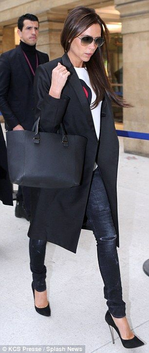 Here she comes: A casual theme permeated Victoria's ensemble thanks to her stylish knee length coat, white T-shirt and skinny jeans