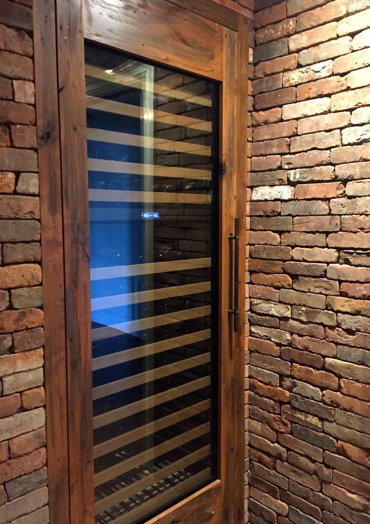 Reclaimed Thin Brick wall veneer in New England Blend creates this outstanding wine cellar.