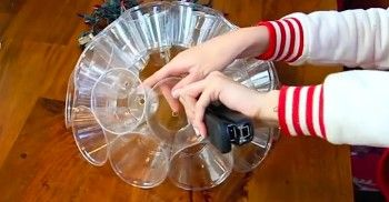 She Staples Plastic Cups Together. Now Watch What Happens When She Turns The Light On...