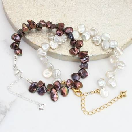A beautiful white or peacock keshi pearl bracelet. A modern twist on a classic pearl bracelet that makes a unique gift for any woman to treasure.