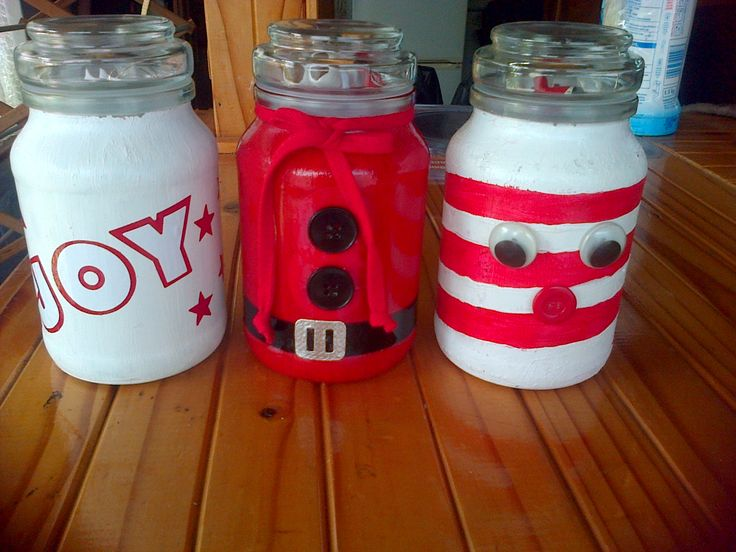 some glass coffee jars, painted, decorated with a xmas theme.