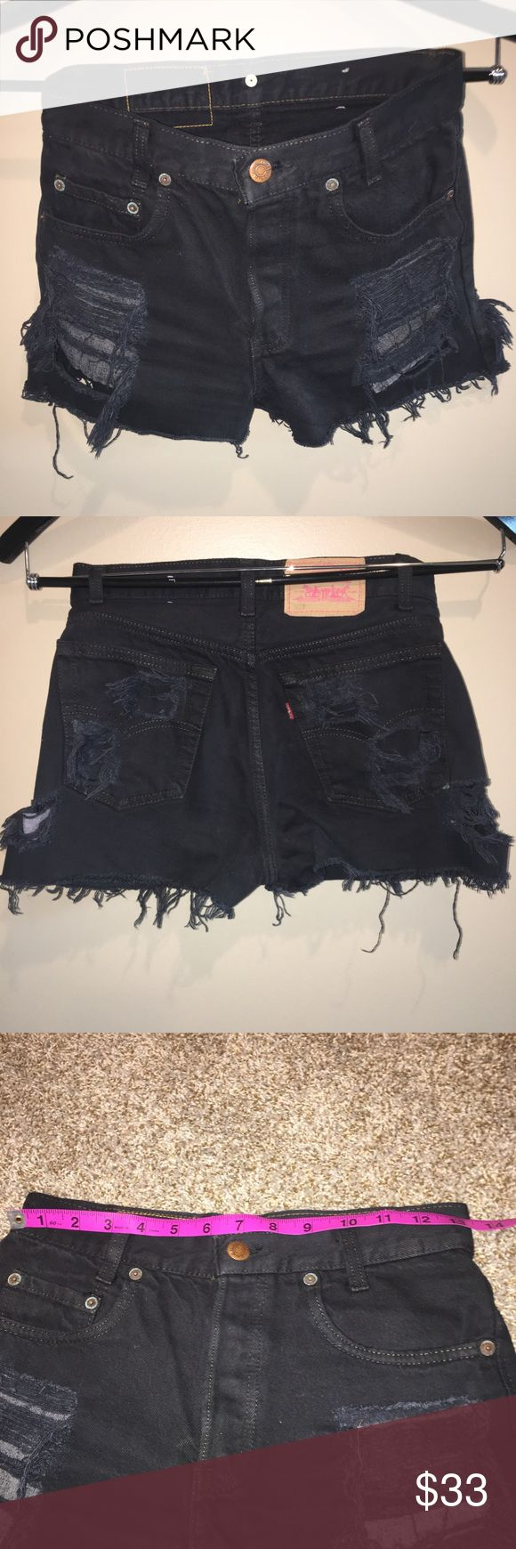 """Levi's destroyed Jean shorts. Levi's 501 black destroyed Jean shorts. No size listed but measure about 13"""" across laid flat. I usually wear size 24/25 and these fit me. 501s are a high rise waist. Levi's Shorts Jean Shorts"""