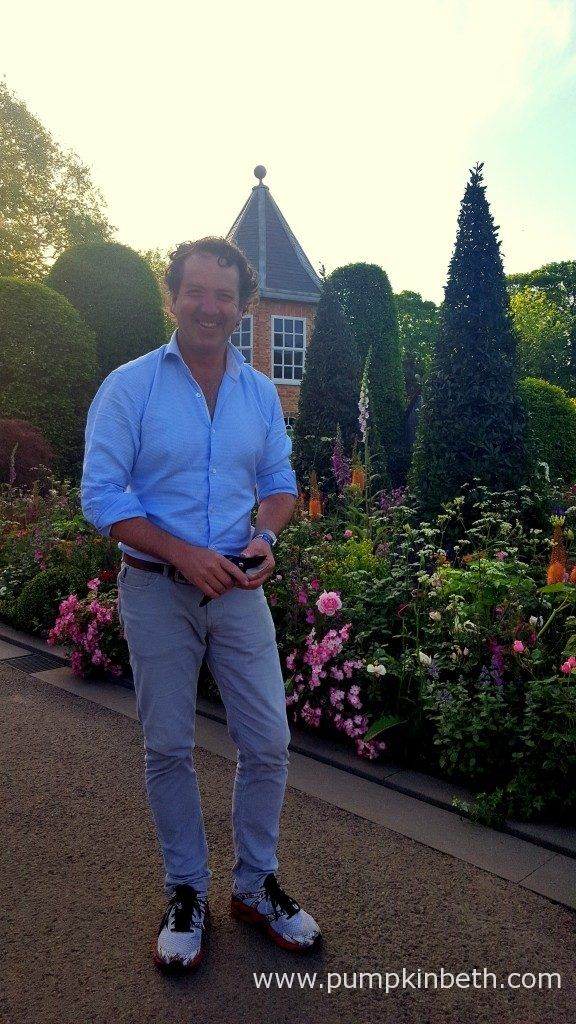 Diarmuid Gavin pictured adding the finishing touches to The Harrods British Eccentrics Garden.  This Show Garden was designed by Diarmuid Gavin, and built by Diarmuid Gavin Designs.  The Harrods British Eccentrics Garden appears at first glance to be a traditionally inspired garden, with influences from arts and crafts and the gardens of British stately homes, with lots of topiary providing regimentation and structure, together with a calming Italianate sunken water feature, but every…