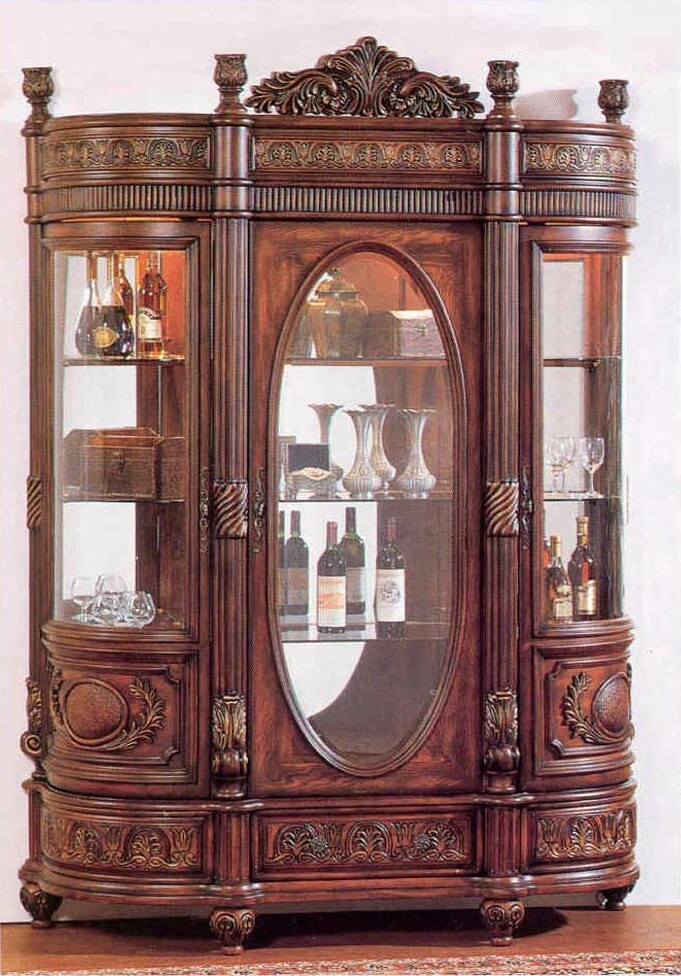 Curio Cabinet  These Large Cabinets Are Used To Store Unusual And  Decorative Items, Such As Wine Bottles, Glass Figures, And Small Antiques.