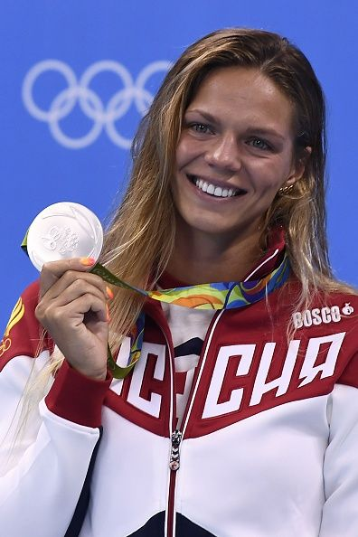#RIO2016 Russia's Yulia Efimova poses with her silver medal on the podium of the Women's 100m Breaststroke during the swimming event at the Rio 2016 Olympic...