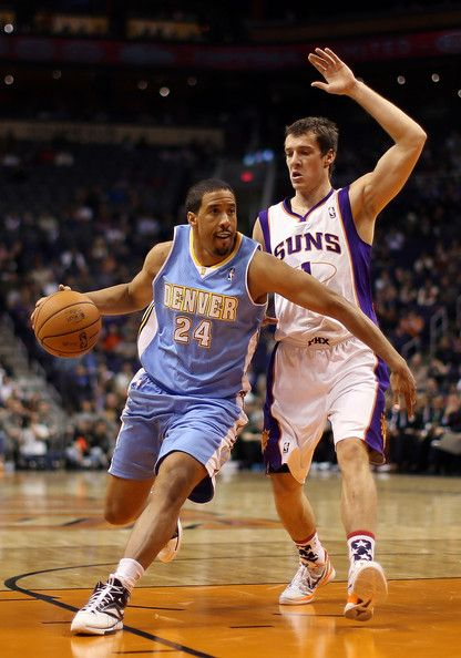 Andre Miller #24 of the Denver Nuggets drives the ball past Goran Dragic #1 of the Phoenix Suns during the NBA game at US Airways Center on November 12, 2012 in Phoenix, Arizona.