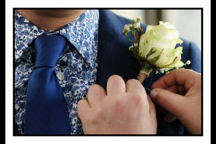 Funky floral patterned grooms wedding shirt. Blue suit.