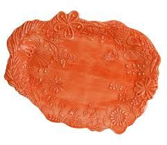 Mateus orange platter absolutely beautiful as a winter warmer on any table.