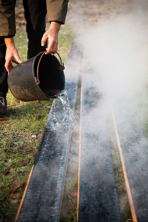 Charring cedar boards - a traditional Japanese technique to preserve timber and make it fire resistant.
