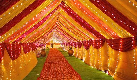 vibrant outdoor wedding tent, red, orange, yellow, tent lighting