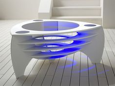 Futuristic Corian Tables by Stuart Melrose