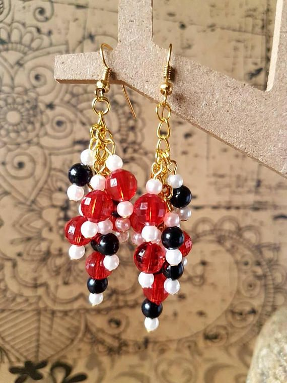 Check out this item in my Etsy shop https://www.etsy.com/au/listing/544954639/ruby-and-black-cluster-drop-earrings