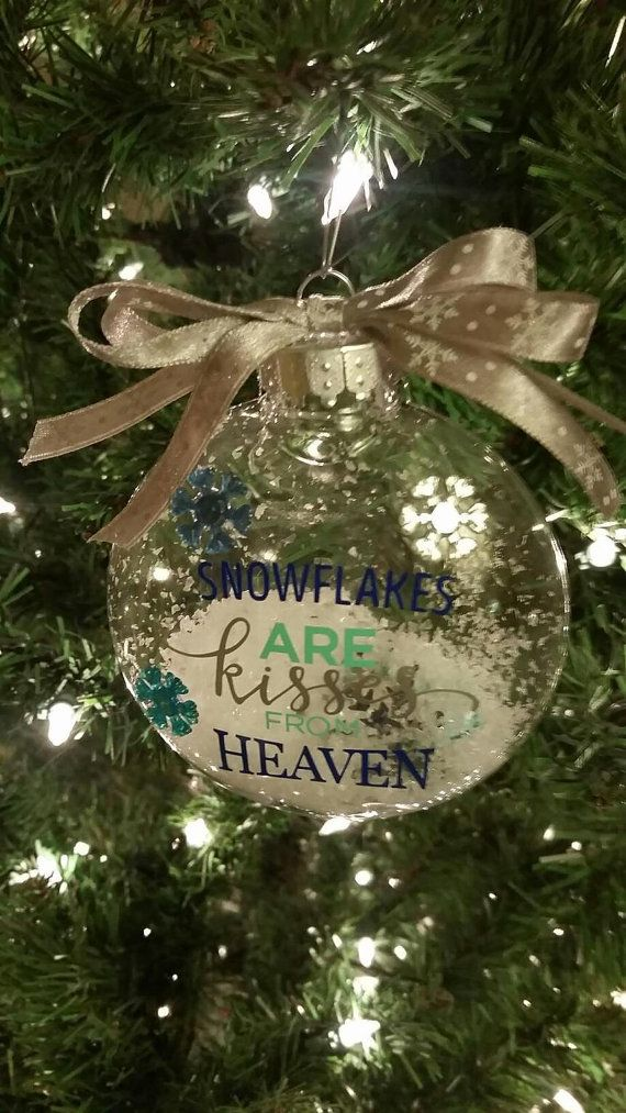 Snowflakes are kisses from heaven ornament 4 in glass ornament hand made with permanent grade adhesive vinyl on the outside with plastic snowflakes and craft snow.