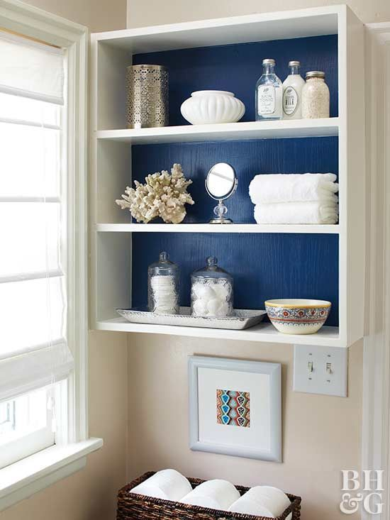 Add colorful contrast to basic white cabinets by wallpapering their back walls. The process is simple—all you need is prepasted wallpaper, measuring tape, and a few other DIY supplies.