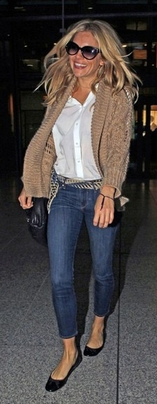 Who made Sienna Miller's skinny jeans and nude cardigan that she wore at Heathrow airport?