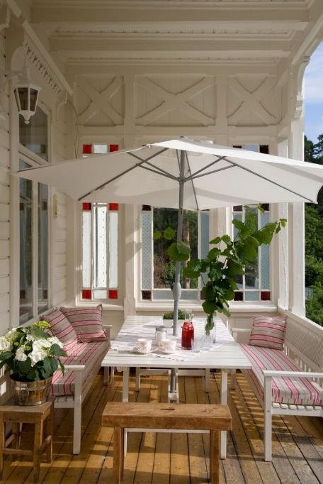 mix of seating, table with benches, white umbrella