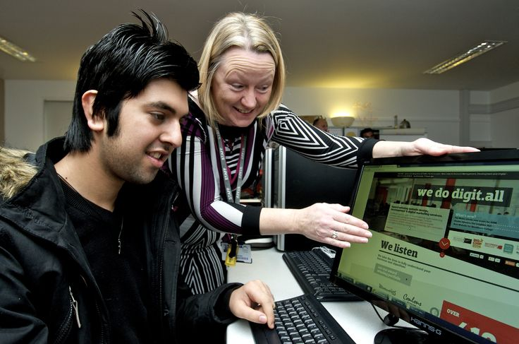 A level 1 student getting help from learning support assistant.