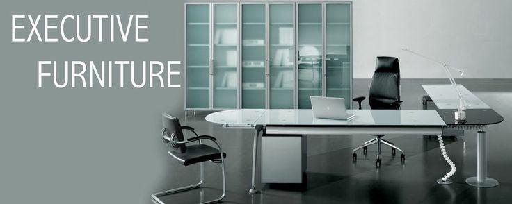 Stunning glass desk - a piece of art in itself.