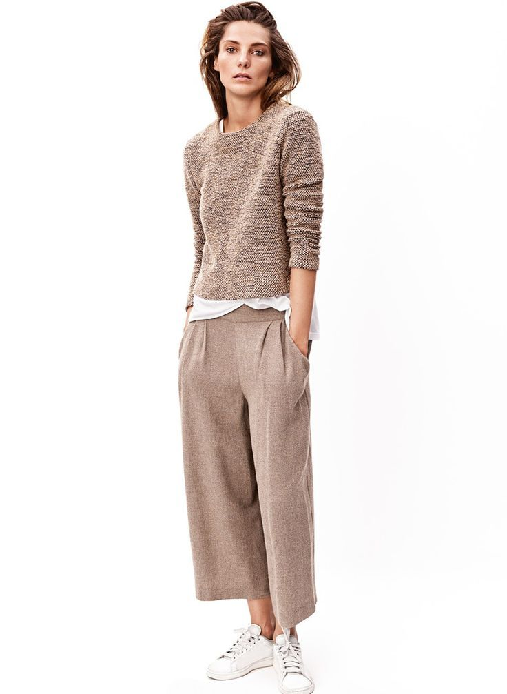 Nude sweater, white shirt underneath and nude wide culottes.