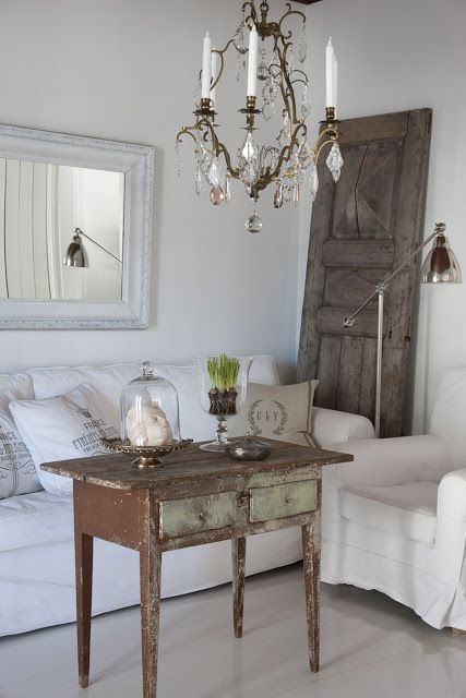 love the elegant white mixed with the rustic wood.