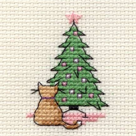 Cat next to Christmas tree cross stitch for Christmas cards.