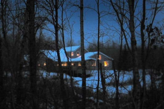 Candle lit house at Magic Pond | Winter at Magic Pond