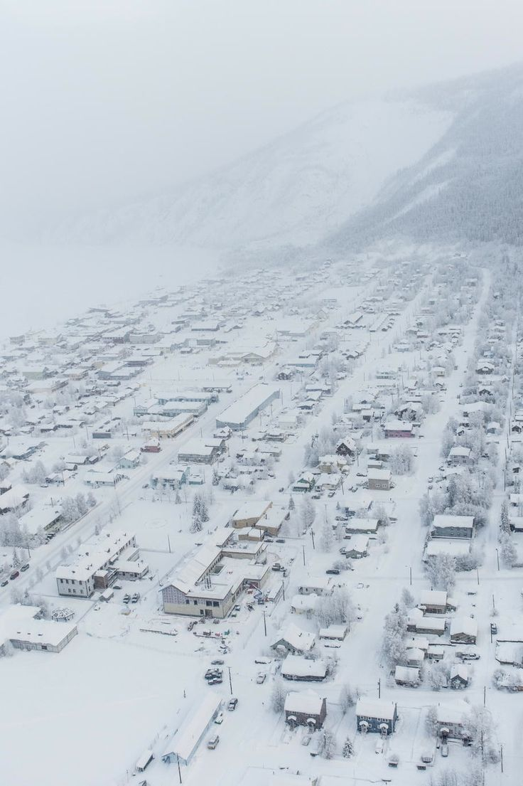 Dawson City, Yukon (by Pat Kane)...I visited Dawson City in Sep so I didn't see snow. I have been told that approximately 1300 people live there year-round, but the number of residents swells between mid-May and mid-Sep...