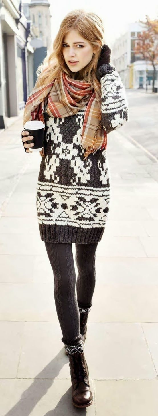 Warming Trends: 8 #streetstyle-inspired ways to wear socks with boots. I love this look, from head to toe! Chunky scrunched socks, leggings, ankle boots, and a pretty graphic sweater dress. https://www.toovia.com/lists/warming-trends-8-street-style-inspired-ways-to-wear-socks-with-boots