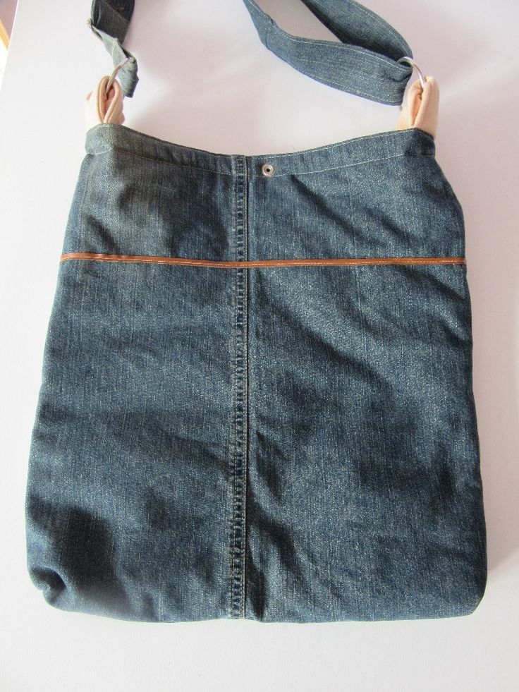 Made from 100% cotton recycled jean denim Eco friendly machine washable   and dryable. Each shoulder bag is independently design no massive production   only one of the kind. Made from recycled a blue and black jeans with light  color liner with two pockets inside.