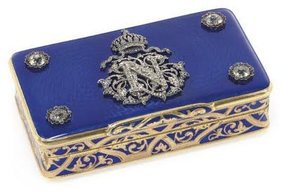 Gold, enamel, gem-set snuff box; Swiss 1848.  The blue guilloche enamel cover is applied with diamonds - set initial and crown of Napoleon III.