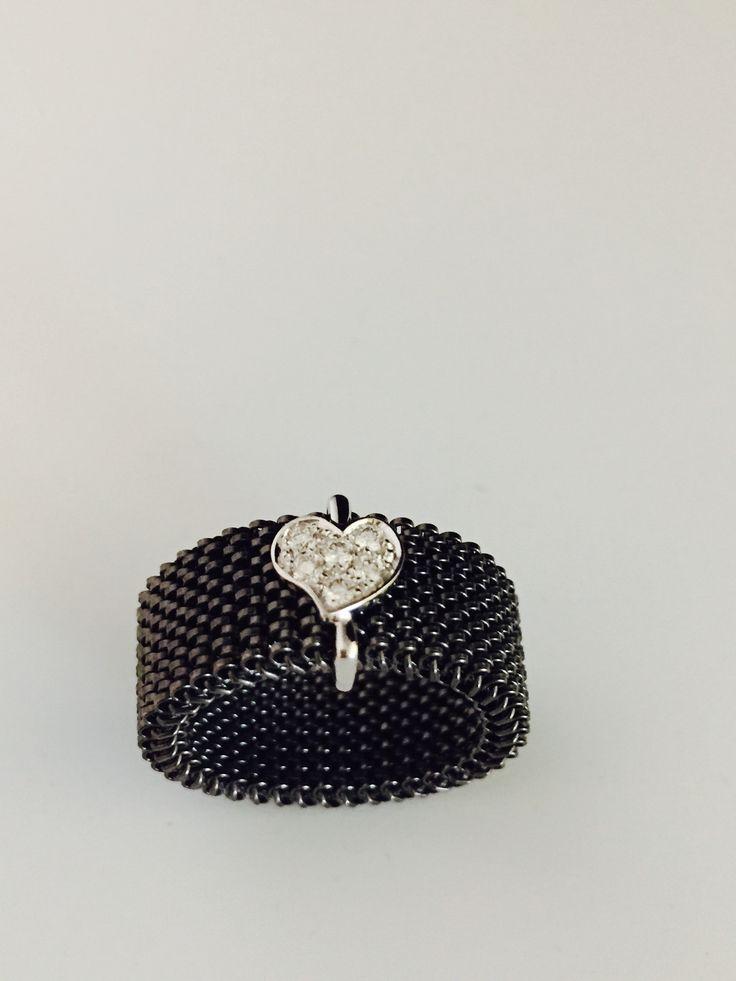 Bague parisienne empierrée . Ring Diamond . Whitegold