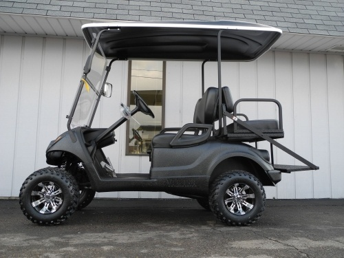 This 2008 Yamaha Drive custom street-ready gas golf cart has been completely upgraded with a huge list of accessories and options to create one of the coolest custom golf carts that we have ever built. Not only is it street ready with premium lights, folding windshield, and horn, but it also features a black premium gloss Line-X body coating (that is super-durable and will sport this shiny gloss finish forever) and the top-of-the-line M rear flip seat with aluminum diamond plate.