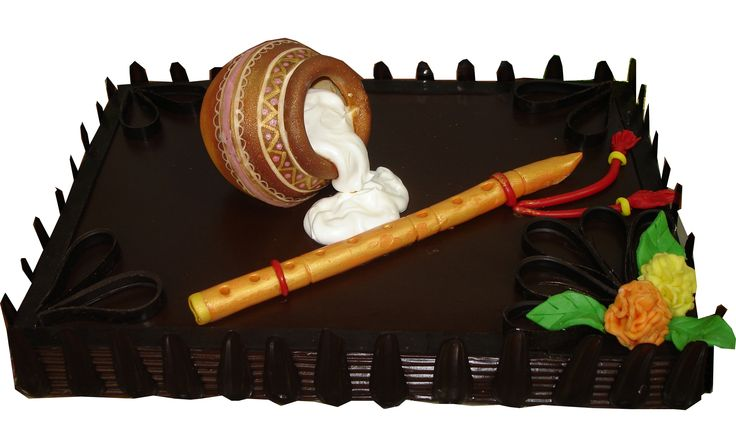 Dahi Handi Cake - A mouth-melting blend of Swiss dark chocolate with the layers of fresh yogurt.. A perfect offering for Lord Shree Krishna… It's an eggless cake and thus everyone can relish it! The major highlight of this cake is the handi & flute which are absolutely EDIBLE! Yes, you can eat the entire Handi filled with sweet yogurt and so can flute! Order Now - http://www.monginis.net/product/dahi-handi-cake/