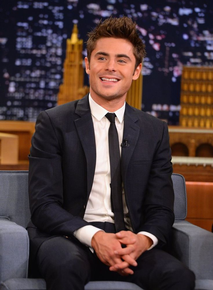 Forget the fact that he looks photoshopped in real life. | Sexy Zac Efron Moments | Pictures | POPSUGAR Celebrity Photo 1