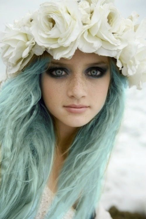 pastel blue hair with white flowers looks enchanting
