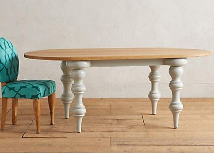 A perfect oval of handcarved oak rests atop oversized, turned and lacquered legs, making this dining table a versatile anchor with just a touch of unexpected whimsy. Anthro. $1700-2k