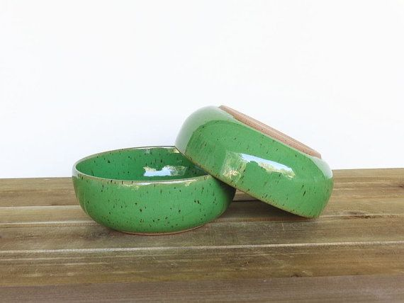 These bowls are wheel thrown in a speckled brown stoneware clay and glazed in a bright green glaze. It is a luscious, glossy glaze.  These bowls are 5 3/4 inches wide and 2 inches tall. They are a great size and shape for soup, cereal, oatmeal or ice cream.  Fired to cone 5 in an electric kiln. Food, dishwasher and microwave safe.  You will receive the exact bowls in the photo. I do not use stock photos - all items for sale in my shop are photographed individually then listed. While I do...