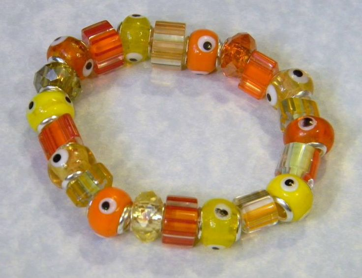 Yellow and Orange Evil Eye, Furnace Cane Bead and Crystal Stretch Bracelet