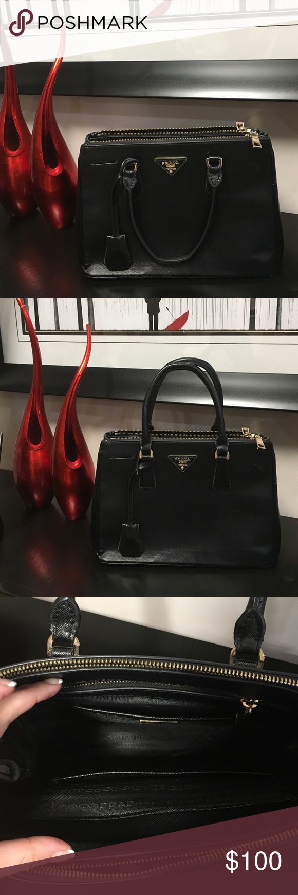 Black Prada Purse Black Purse in good condition. Medium size. Price reflects authenticity. Feel free to ask questions. Prada Bags Totes