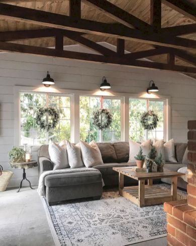 Love the detail in the ceiling, the beams, the shiplap, and lighting over the windows