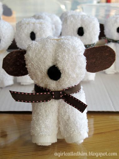 DIY wash cloth puppy.  Great idea for a baby shower- you can make them in so many different colors. (it looks more like a sheep or lamb)
