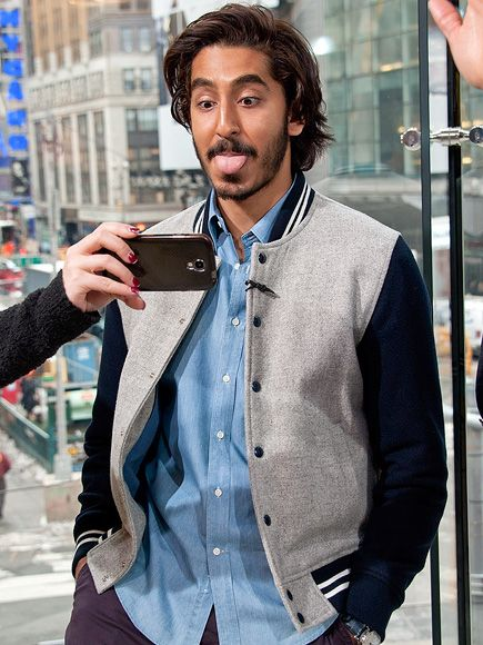 Dev Patel makes the case for silly selfies while on the N.Y.C. set of Extra in the Times Square H&M on Tuesday