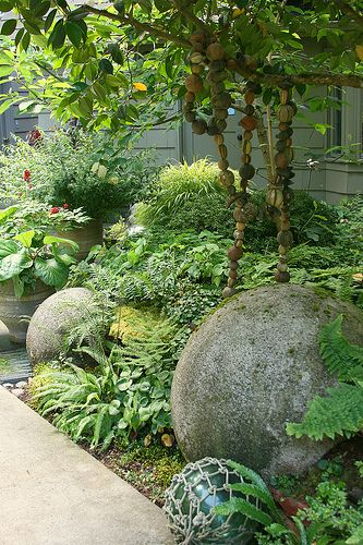 I do love spheres in the garden and the hanging ceramic beads add an eclectic artistic touch of creativity.