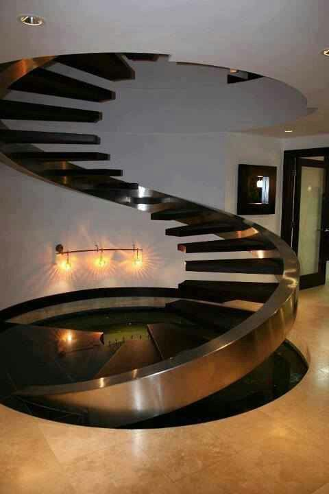 Modern floating staircase. Its so beautiful it looks like a sculpture, not stairs.