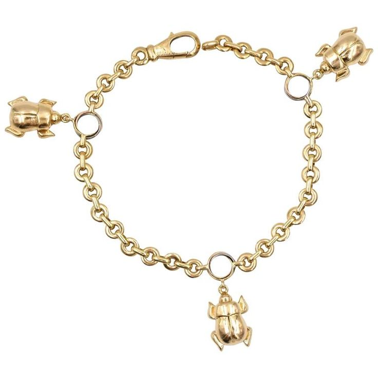 Cartier Three Beetle Gold Charm Bracelet | From a unique collection of vintage charm bracelets at https://www.1stdibs.com/jewelry/bracelets/charm-bracelets/