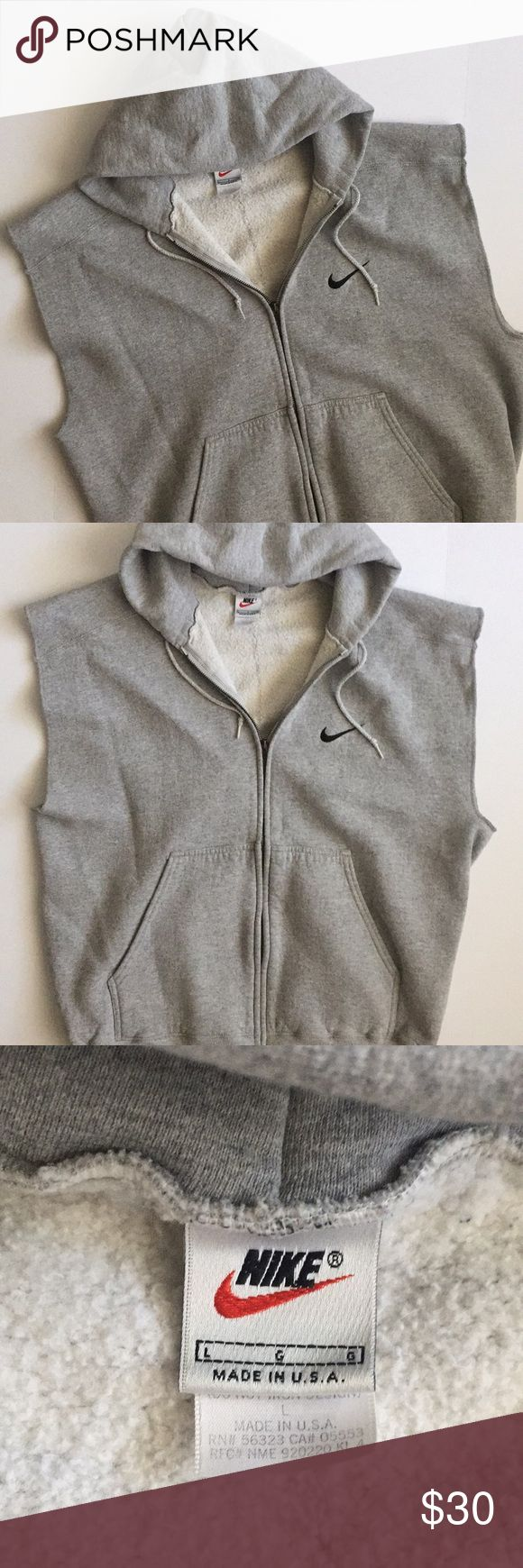 """Gray Nike sweatsuit hoodie with cutoff sleeves Light gray sweatshirt with drawstring hoodie, zip up front, front pockets, and cutoff, oversized sleeves. Nike embroidered logo on chest. Could be unisex!   85% cotton 15% polyester   Measurements are approximate:  Armpit to armpit- 25.5"""" Length (shoulder to hem)- 26-26.5"""" Nike Men's Large (L) Nike Shirts Sweatshirts & Hoodies"""