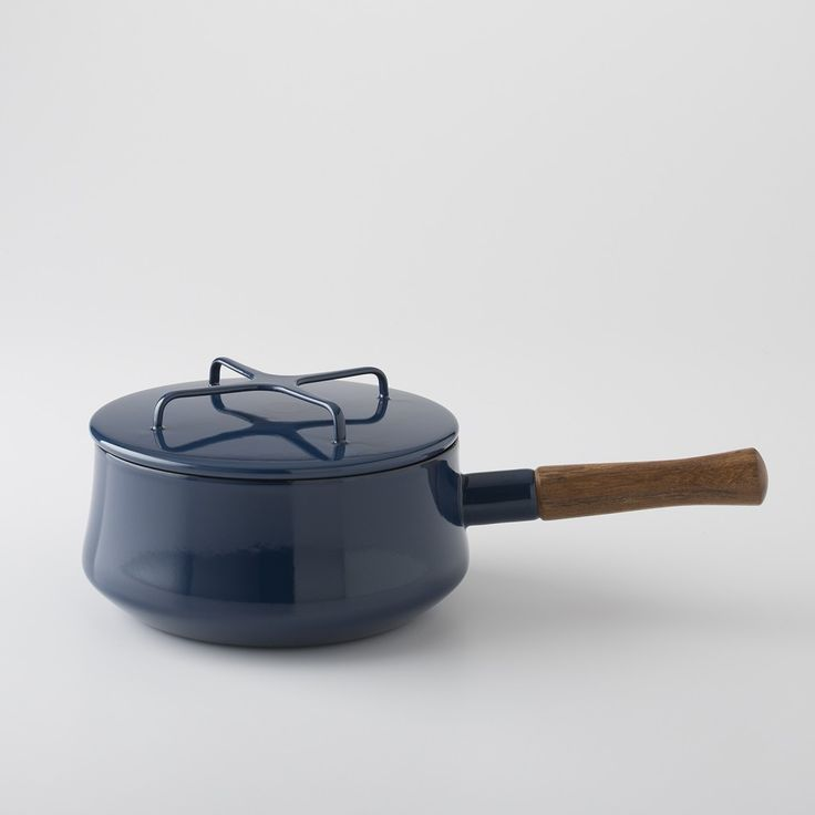 After 20 years out of production, Dansk cookware is back. Made of light-weight enameled steel, this 2-quart saucepan can go right from your stovetop to the table thanks to the lid which doubles as a trivet. High-gloss navy blue exterior with white interior and wooden sculptural handle.